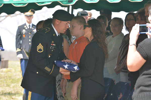 Billy Owens receives the flag off of Sgt. Timothy Owens' casket at his funeral on Saturday in Rolla, Mo.