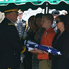 Army members give Timothy Owens' children flags at his funeral Saturday.