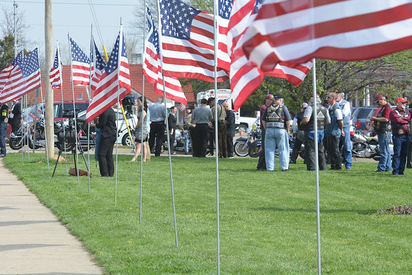 Flags line Rolla Street across from First Baptist Church at the funeral.