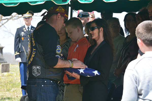 Mark Williams gives Billy Owens a plaque at Sgt. Timothy Owens' funeral in Rolla Saturday.