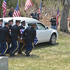 Tiothy Owens' casket is brought to its final resting place by the United Sates Army Honor Guard at his funeral on Saturday.