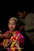 An Older Brother Dresses A Jeweled Prince In Maehongson, Thailand As Part of Poi Sang Long Festival