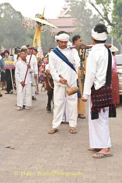 Shan Men Banging A Gong