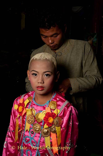 An Older Brother Dresses A Jeweled Prince At Wat Hua Wiang, Maehongson