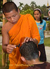 Young Monk Shaving Head of Young Shan Boy at Start of Poi Sang Long Ritual in Front of Wat Jong Kum-Jong Klang in Maehongson, Thailand