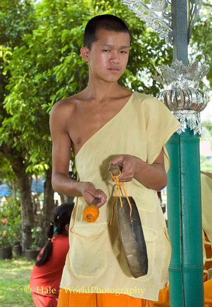 Young Monk Playing Music Prior to Hair Cutting Ritual