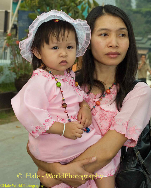 Young Shan Mother Carrying Her daughter Through Maehongson During Poi Sang Long Festival