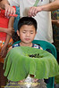 Young Shan Boy Having His Hair Cut as Start of Poi Sang Long in Front of Wat Jong Kum-Jong Klang in Maehongson, Thailand