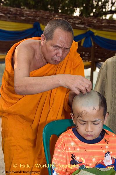 Abbott Shaving a Young Shan Boy's Head as part of Poi Sang Long Ritual, Maehongson, Thailand