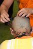 Young Monk Shaving Head of Young Shan Boy at Start of Poi Sang Long Ritual in Front of Wat Jong Kum-Jong Klang in Maehongson, Thailand
