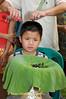 Young Shan Boy Having His Hair Cut as Start of Poi Sang Long in Front of Wat Jong Kum-Jong Klang in Maehongson, Thailand
