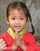 Young Shan Girl Giving Wai Greeting During Poi Sang Long Festival, Maehongson, Thailand