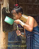 Padaung Woman Brushing Her Teeth, Huay Sua Tao, Thailand