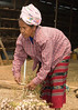 Shan Woman Preparing Garlic to be Hung in Drying Barn