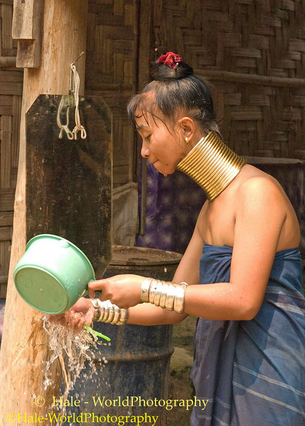 Padaung Woman Brushing Her Teeth, Huay Sua Tao, Thailand