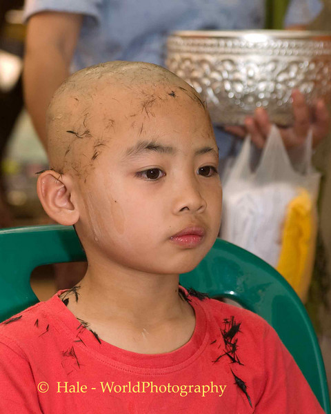 Shaved Head of Young Shan Boy at Start of Poi Sang Long Ritual in Front of Wat Jong Kum-Jong Klang in Maehongson, Thailand