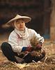Shan Woman With Thanakha Makeup Bundling Garlic In Ban Nai Soi