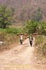Workers Hauling Garlic In Maehongson Province