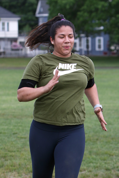 Lady Laguna of Lowell, does a half hour workout at Shedd Park with a friend. They started doing it daily a couple of weeks ago due to the COVID-19 quarantine.  (SUN/Julia Malakie)