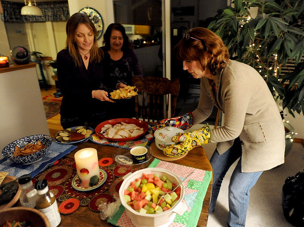 "Gezele Gervais, left, Joice Fairchild, and Mimi Shannon set out the dinner dishes for the Shine meeting.<br /> Mimi Shannon and her daughter, Kim, run a monthly woman's group called the Shine Sisters' Circle, using the Shine cards to unlock women's inner creativity, strength and deep desire to be who they are.<br /> For more photos of the group, go to  <a href=""http://www.dailycamera.com"">http://www.dailycamera.com</a>.<br /> January 5, 2012 / Cliff Grassmick"