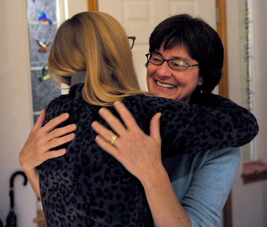 "Kim Shannon, left, has a greeting hug for Katie Heldman, before the Shine meeting.<br /> Mimi Shannon and her daughter, Kim, run a monthly woman's group called the Shine Sisters' Circle, using the Shine cards to unlock women's inner creativity, strength and deep desire to be who they are.<br /> For more photos of the group, go to  <a href=""http://www.dailycamera.com"">http://www.dailycamera.com</a>.<br /> January 5, 2012 / Cliff Grassmick"