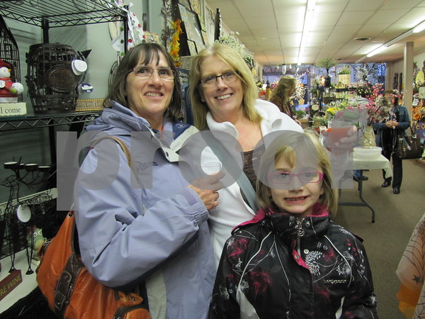 Bev Fortney, Melanie Fortney, and Gabby Waldschmidt enjoying an evening of shopping at 'Girls Night Out'.