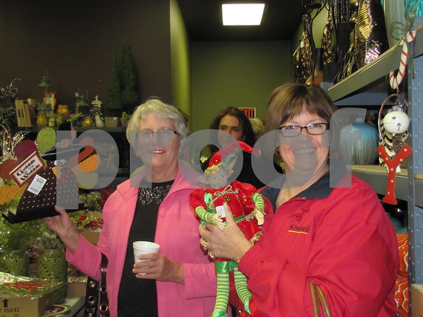 Mardel Stream and Jodi Janke show off some cute finds at 'Real Deals'.
