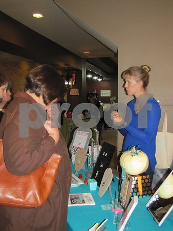 Katie Moser was set up at Studio Fusion to show the line of custom jewelry from 'Origami Owl'.