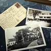 "Old postcards and photos belonging to former Wilmington town clerk Patti Ward, a longtime resident on the shore of Silver Lake. Clockwise from left, a postcard from New Brunswick her mother received in 1937, addressed to ""Silver Lake, Wilmington,"" and a photo and a postcard of The Elms, which is still on Glen Road. (SUN/Julia Malakie)"