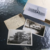 "Old postcards and photos belonging to former Wilmington town clerk Patti Ward, a longtime resident on the shore of Silver Lake. Clockwise from left, a postcard from New Brunswick her mother received in 1937, addressed to ""Silver Lake, Wilmington,"" a photo of the Silver Lake School, once where the Town Beach parking lot is now, and two views of The Elms, which is still on Glen Road. (SUN/Julia Malakie)"