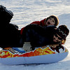 "Joaquin Stewart, top and his father, Juan, slide down the hill at Scott Carpenter Park.<br /> For more photos of sledding, go to  <a href=""http://www.dailycamera.com"">http://www.dailycamera.com</a><br /> Cliff Grassmick / January 11, 2011"