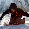 "Manuel Compeas, 9, tries to build up speed while sledding at Scott Carpenter on Tuesday.<br /> For more photos of sledding, go to  <a href=""http://www.dailycamera.com"">http://www.dailycamera.com</a><br /> Cliff Grassmick / January 11, 2011"