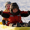 "Jean-Perre Juilland, left, and Derrick Weiss, slide down the hill at Scott Carpenter Park on Tuesday.<br /> For more photos of sledding, go to  <a href=""http://www.dailycamera.com"">http://www.dailycamera.com</a><br /> Cliff Grassmick / January 11, 2011"