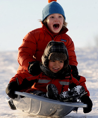 "Luciene Juilland-King, top, and Derrick Weiss, get a thrill going down the hill at Scott Carpenter Park.<br /> For more photos of sledding, go to  <a href=""http://www.dailycamera.com"">http://www.dailycamera.com</a><br /> Cliff Grassmick / January 11, 2011"