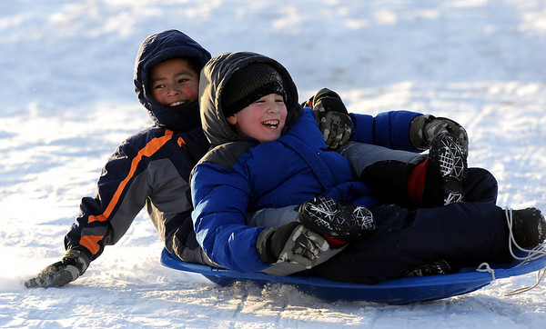 "Manuel Compeas, left, 10, and Andrew Bastres, 9, fly down Scott Carpenter sledding hill on Tuesday.<br /> For more photos of sledding, go to  <a href=""http://www.dailycamera.com"">http://www.dailycamera.com</a><br /> Cliff Grassmick / January 11, 2011"