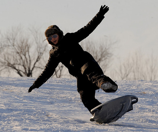 "Huong Weiss loses control of her sled at Scott Carpenter Park on Tuesday.<br /> For more photos of sledding, go to  <a href=""http://www.dailycamera.com"">http://www.dailycamera.com</a><br /> Cliff Grassmick / January 11, 2011"