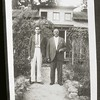 Two Men in Front of a House (03879)