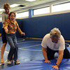 "Physical therapist, Janice Moore, left, helps Sophia Ruggeri, as  her father Jay,  horses around to make her laugh.<br /> Sophia Ruggeri, a senior at Centaurus High School with special needs, and her father Jay, believe she should go to the same events as all the other students.They believe the school district shouldn't have special events for kids with special needs.<br /> For more photos and a video of the tour, go to  <a href=""http://www.dailycamera.com"">http://www.dailycamera.com</a>.<br /> Cliff Grassmick / April 28, 2010"
