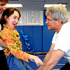 "Physical therapist, Janice Moore, left, helps Sophia Ruggeri, as  her father Jay,  encourages her to walk.<br /> Sophia Ruggeri, a senior at Centaurus High School with special needs, and her father Jay, believe she should go to the same events as all the other students.They believe the school district shouldn't have special events for kids with special needs.<br /> For more photos and a video of the tour, go to  <a href=""http://www.dailycamera.com"">http://www.dailycamera.com</a>.<br /> Cliff Grassmick / April 28, 2010"