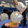 "Jay Ruggeri runs an exercise ball over his daughter Sophia during a therapy session.<br /> Sophia Ruggeri, a senior at Centaurus High School with special needs, and her father Jay, believe she should go to the same events as all the other students.They believe the school district shouldn't have special events for kids with special needs.<br /> For more photos and a video of the tour, go to  <a href=""http://www.dailycamera.com"">http://www.dailycamera.com</a>.<br /> Cliff Grassmick / April 28, 2010"