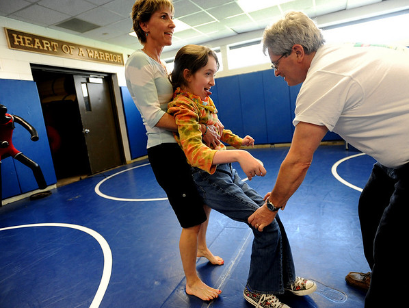 "Physical therapist, Janice Moore, left, helps Sophia Ruggeri, as does her father Jay, on April 28, 2010.<br /> Sophia Ruggeri, a senior at Centaurus High School with special needs, and her father Jay, believe she should go to the same events as all the other students.They believe the school district shouldn't have special events for kids with special needs.<br /> For more photos and a video of the tour, go to  <a href=""http://www.dailycamera.com"">http://www.dailycamera.com</a>.<br /> Cliff Grassmick / April 28, 2010"
