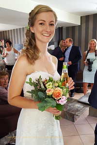 Wedding day: Ilona, showing the flowers and enjoying the early morning drink ;-)