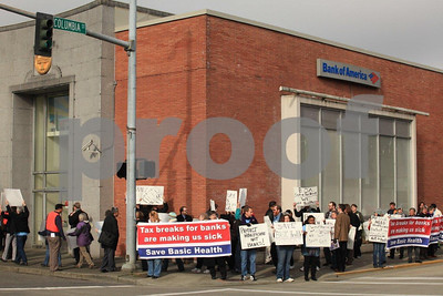 People protesting the healthcare policies of the Bank of America in Olypmpia, WA on Feb. 10, 2011.