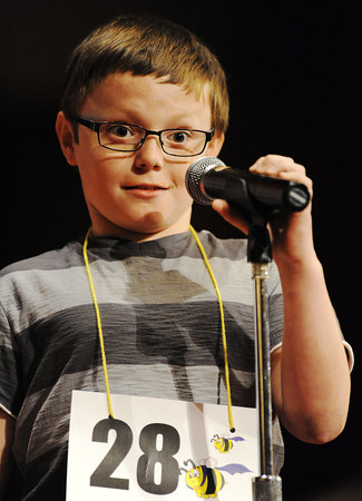 Globe/T. Rob Brown<br /> Landon Cummins, a fourth grader from Frank Layden Elementary School in Frontenac, Kan., reacts to a word during the Joplin Globe Spelling Bee Monday morning, March 18, 2013.