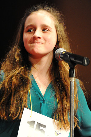 Globe/T. Rob Brown<br /> Annaliese Vorhees, a fifth grader at Columbia Elementary School in Joplin, smiles after correctly spelling a word during the Joplin Globe Spelling Bee Monday morning, March 18, 2013.