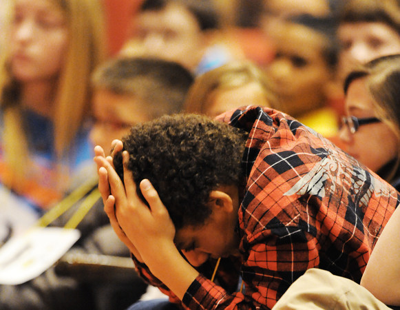 Globe/T. Rob Brown<br /> Julian Garrett, a fifth grader with Cecil Floyd Elementary School in Joplin, prepares himself to take the stage with the next group during the Joplin Globe Spelling Bee Monday morning, March 18, 2013.