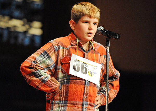 Globe/T. Rob Brown<br /> Joshua Lingar, a fifth grader from Wilson Elementary School in Miami, Okla., spells a word during the Joplin Globe Spelling Bee Monday morning, March 18, 2013.