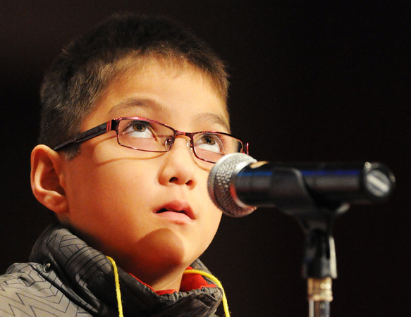 Globe/T. Rob Brown<br /> Ethan K. Nichols, a Carterville Elementary School fourth grader, tries to recall a spelling during the Joplin Globe Spelling Bee Monday morning, March 18, 2013.