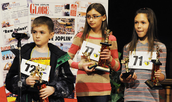Globe/T. Rob Brown<br /> The top three finalists of The Joplin Globe Spelling Bee finalists, Silvio Venturella (second place), Jaden Gallagher (first place) and Kelsey Kerrigan (third place) Monday morning, March 18, 2013.