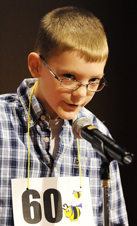Globe/T. Rob Brown<br /> Cash Armstrong, of Miami, Okla., looks to the judges to see if his spelling was correct during the Joplin Globe Spelling Bee Monday morning, March 18, 2013.